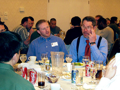 Dr. Johnson fields questions at lunch in Westboro, MA (2004)